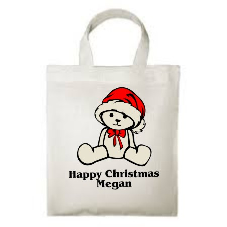 "A reuseable 100% cotton children's Tote Bag, printed with a cute Christmas teddy, your child's name and ""Happy Christmas"""