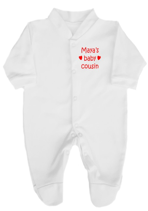 """Lovely babygrow personalised with big cousin's name and """"baby cousin"""" and a couple of hearts. Available in a wide choice of text colours."""