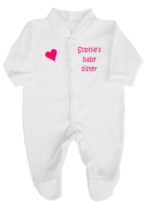 This cute baby sister babygrow will make a lovely new baby gift. Printed on the right with a heart and left personalised with big sister or brother's name.