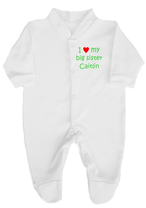"100% cotton, fully machine washable babygrow printed on the left breast with ""I love (heart) my big sister"" and personalised with her name."