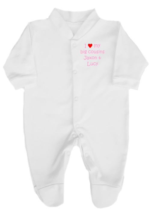 "This lovely baby's babygrow sleepsuit is made with easy fitting and secure press-stud fastenings. printed ""I love (red heart) my Cousins""."